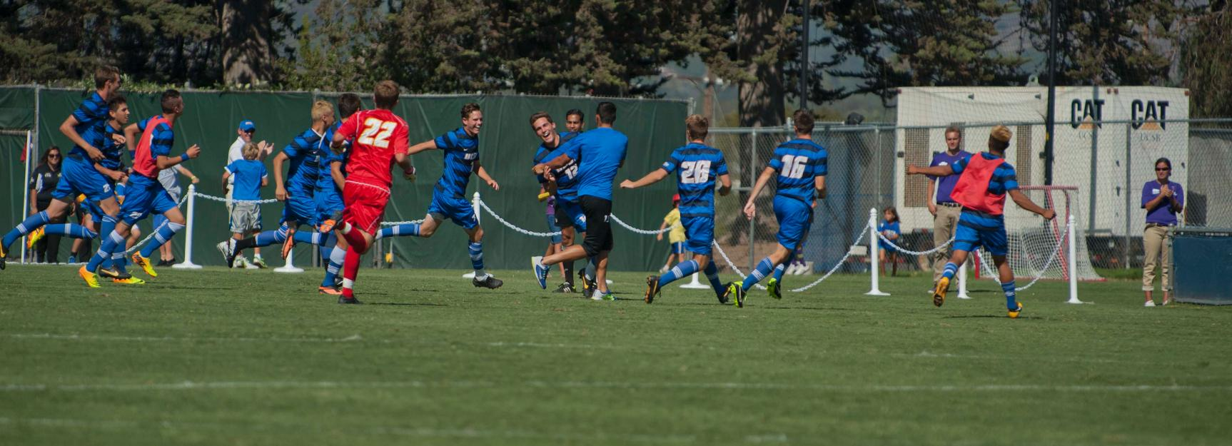 Charlie Miller and the Gauchos celebrate a golden goal (Photo by Tony Mastres)