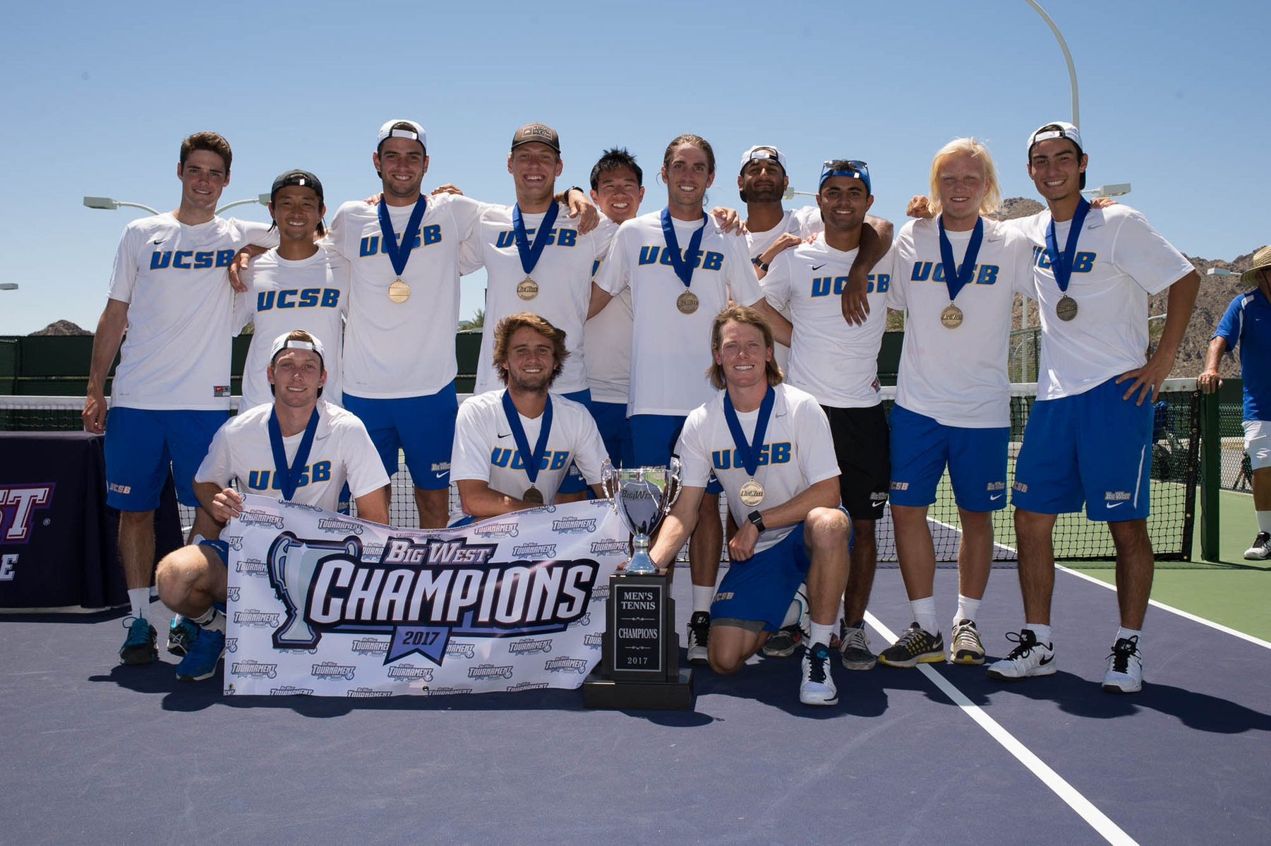 The UCSB men's tennis team (above) looks on after clinching their third straight Big West title on Sunday.