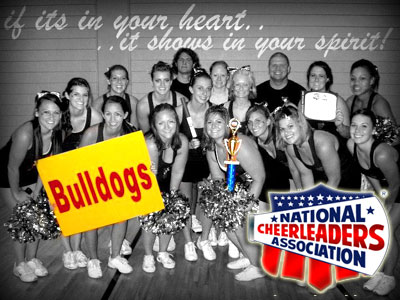 The FSU Cheerleading Team poses with the trophy the Bulldog received at the recent NCA Collegiate Summer Camp (Courtesy Photo)
