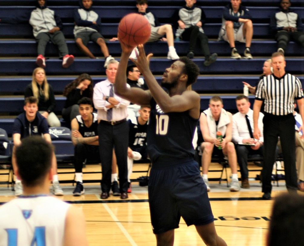 Sophomore Ilunga Moise contributed with a double-double of 18 points and 10 rebounds off the bench in Pima's 115-99 win over Macomb Community College. The Aztecs improved to 11-1 overall. Photo by Stephanie Van Latum.