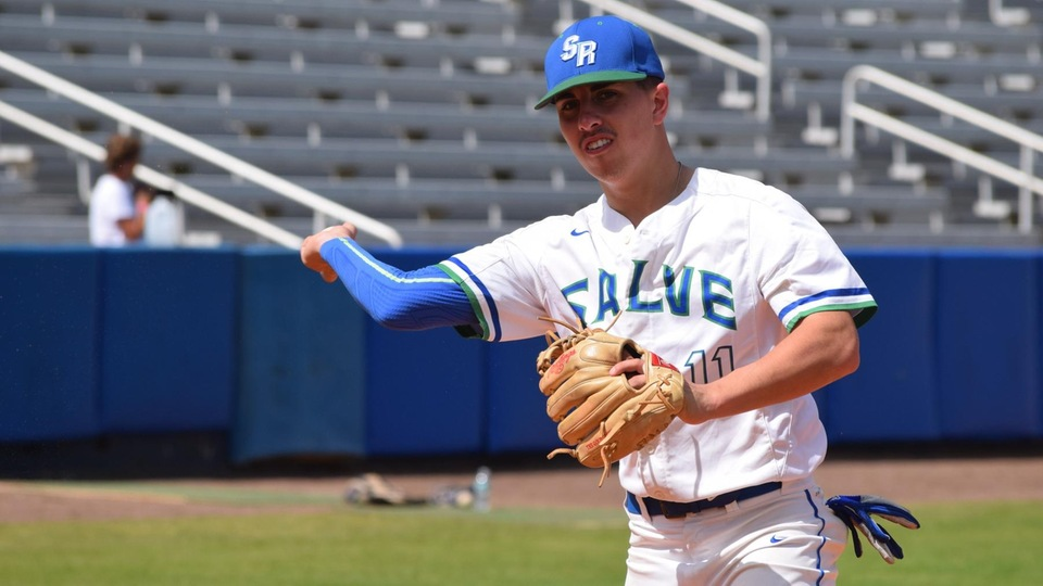 Salve Regina sophomore Dustin Siqueira drove in two runs during late-inning rallies with a sac fly and a double in the Seahawks' 8-6 win against the Tigers. (Photo by Ed Habershaw)