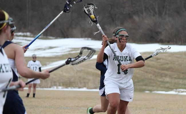 Senior Caroline Arancio (number 14) scored four goals, one of three student-athletes with four goals, as the Keuka College women's lacrosse team knocked off Cazenovia College 16-5 Saturday (photo courtesy of Carly Volante, Keuka College Sports Information Department).