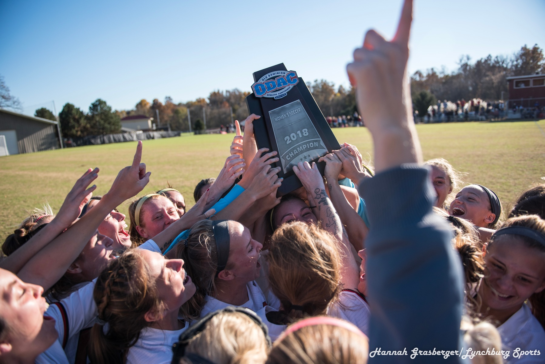 Lynchburg women's soccer players hoist the ODAC championship trophy