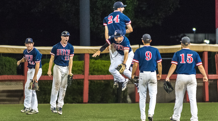 The Blue Dragons celebrate after Julian Rip's game-saving catch in the ninth inning of Hutchinson's 12-11 Region VI/Central District Tournament victory over Johnson County on Sunday night in Wichita. (Allie Schweizer/Blue Dragon Sports Information)