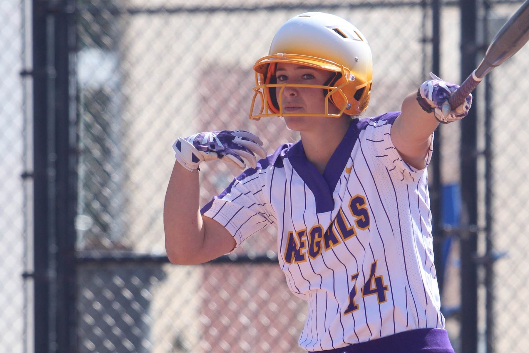 Catherine Slabaugh comes up with a clutch RBI single to CLU a 7-6 win against Whittier. (Photo: Danielle Roumbos)