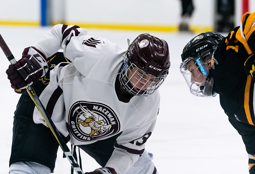 Chantal Ricker lines up for a faceoff against Olds during a recent game (Matthew Jacula photo).