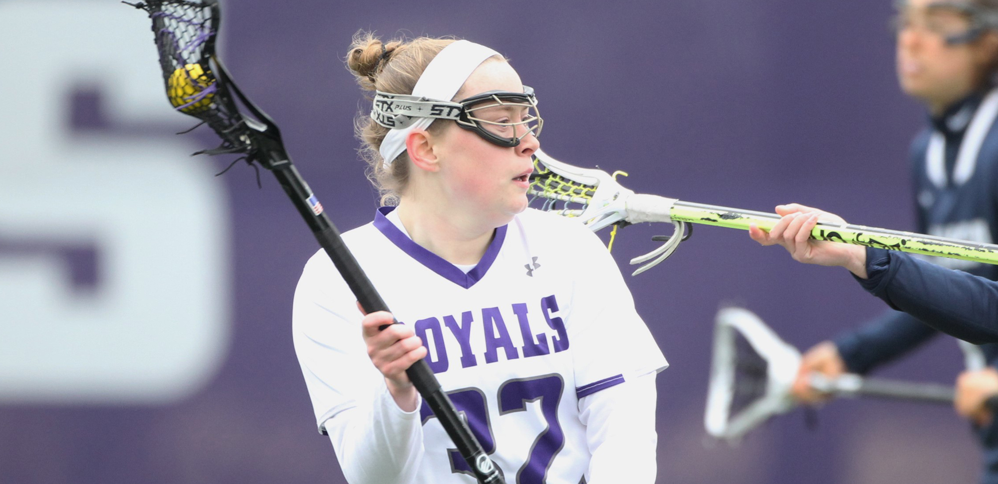 Senior Christine Olert scored a game-high five goals to lead the Royals to a thrilling 12-11 win at Drew on Wednesday afternoon to remain unbeaten in the Landmark Conference. © Photo by Timothy R. Dougherty / doubleeaglephotography.com