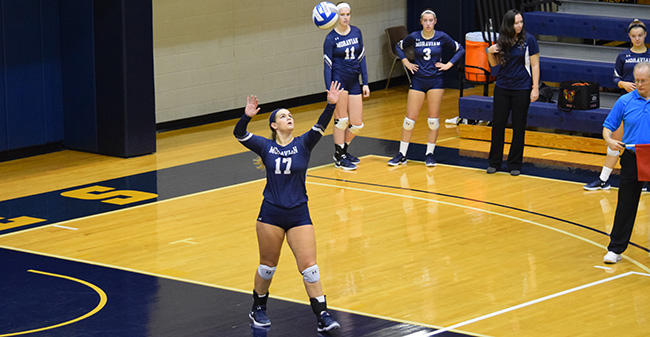 Mary Zacher '18 serves up the ball during a Landmark Conference Semifinal match at No. 22 Juniata College.