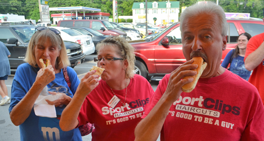 Hometown fans enjoy Purple Pride Caravan on National Hot Dog Day
