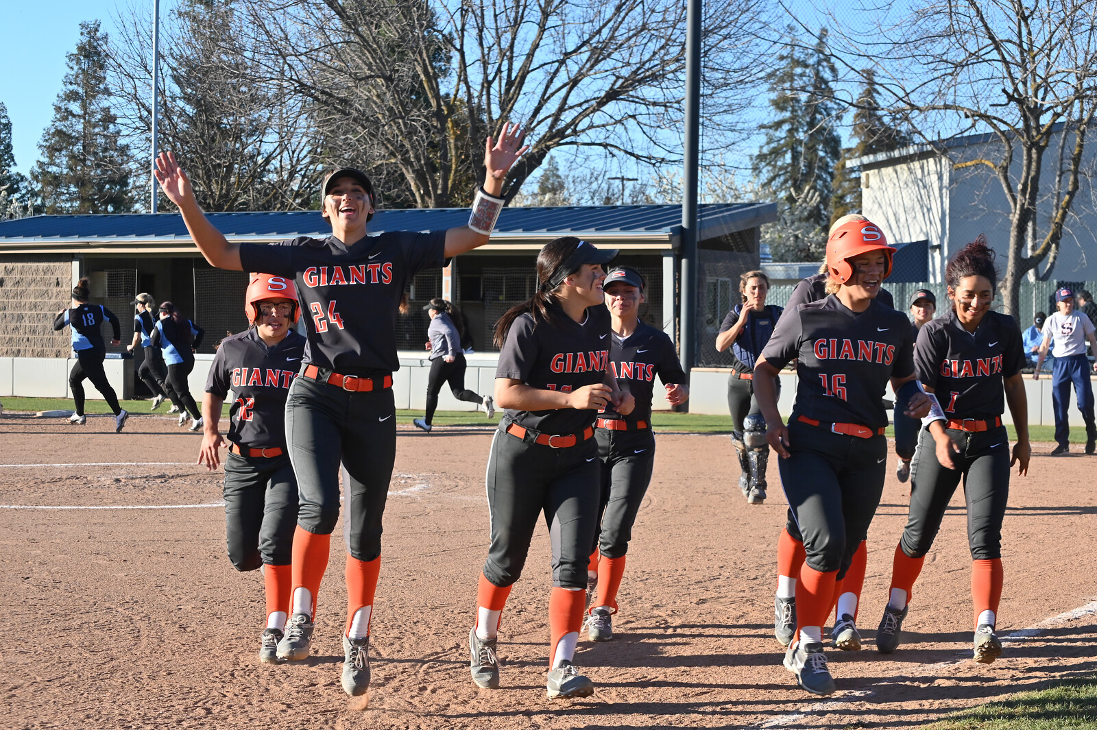Softball celebrates in 2019 after a win.