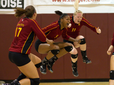 Aly Brecht (#17) and Samantha Fordyce (#11) celebrate Arielle Goodson's (#5) match-winning kill.  (Photo by Ben Amato)