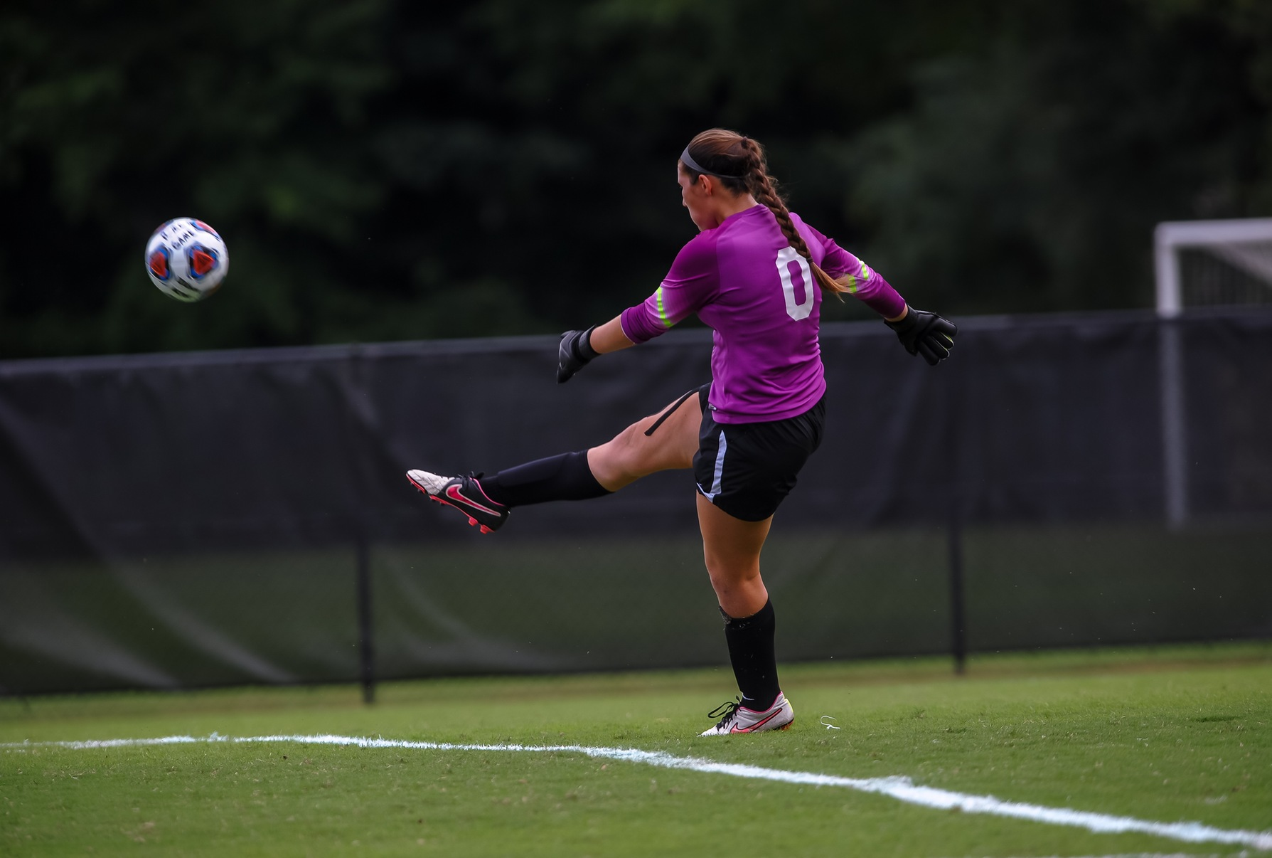 Christina Newman kicking the ball