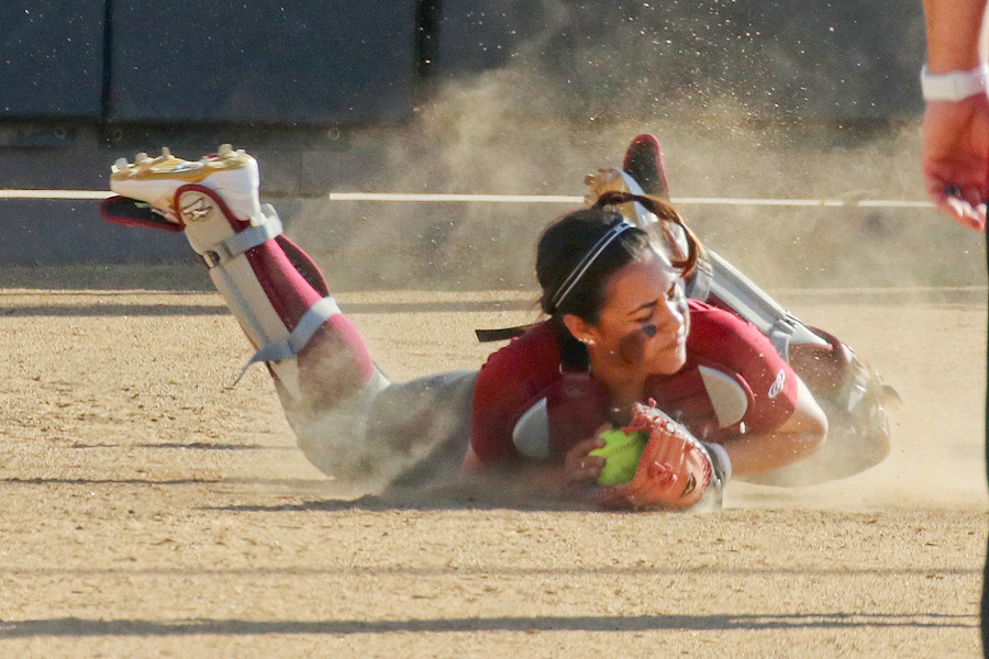 Jeneve Medrano makes the diving popup catch at home - Richard Quinton