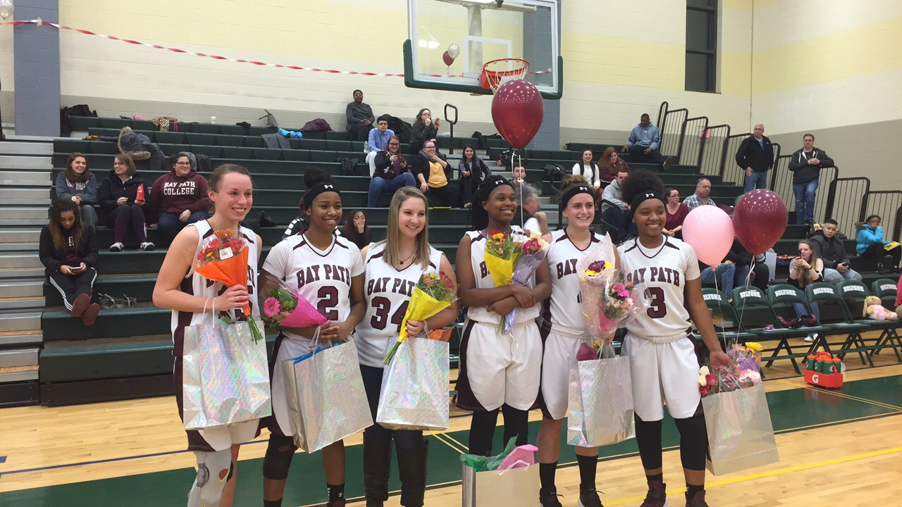 Jackson Scores 1,000th Point Leading Wildcats to a Senior Night Victory