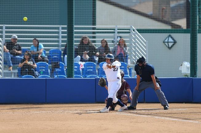 Briana Lopez launches the first of her two home runs against Compton