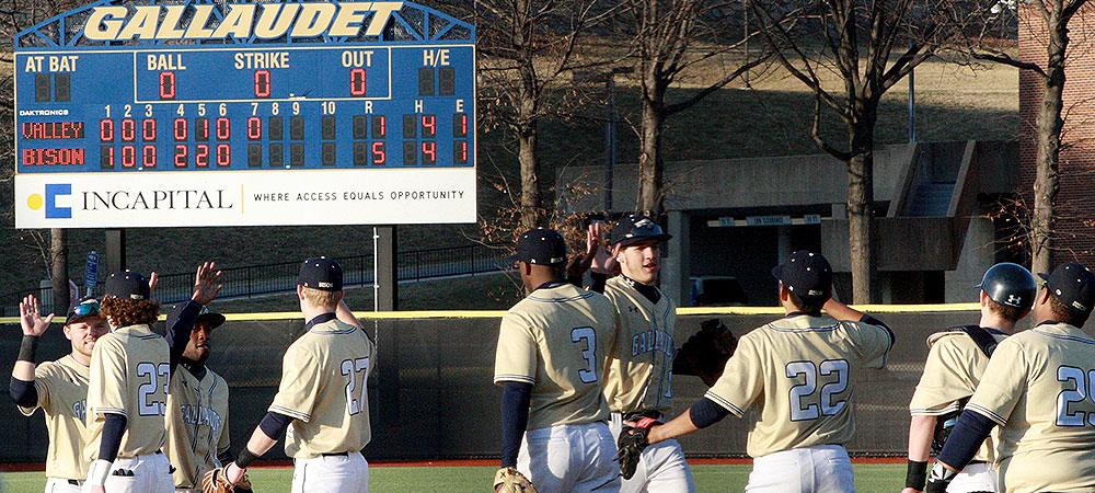 Gallaudet baseball players exchange high-fives after they won a game at home on Hoy Field.