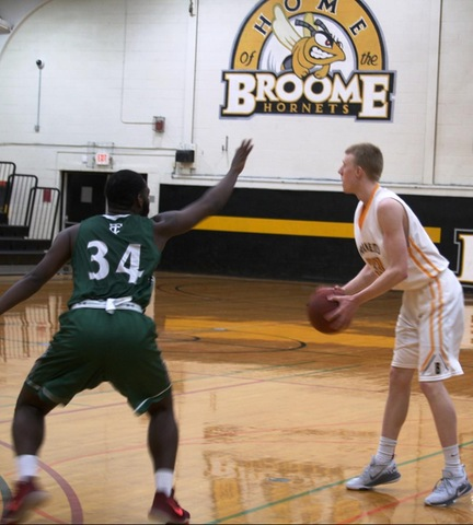 SUNY Broome player defended by opponent
