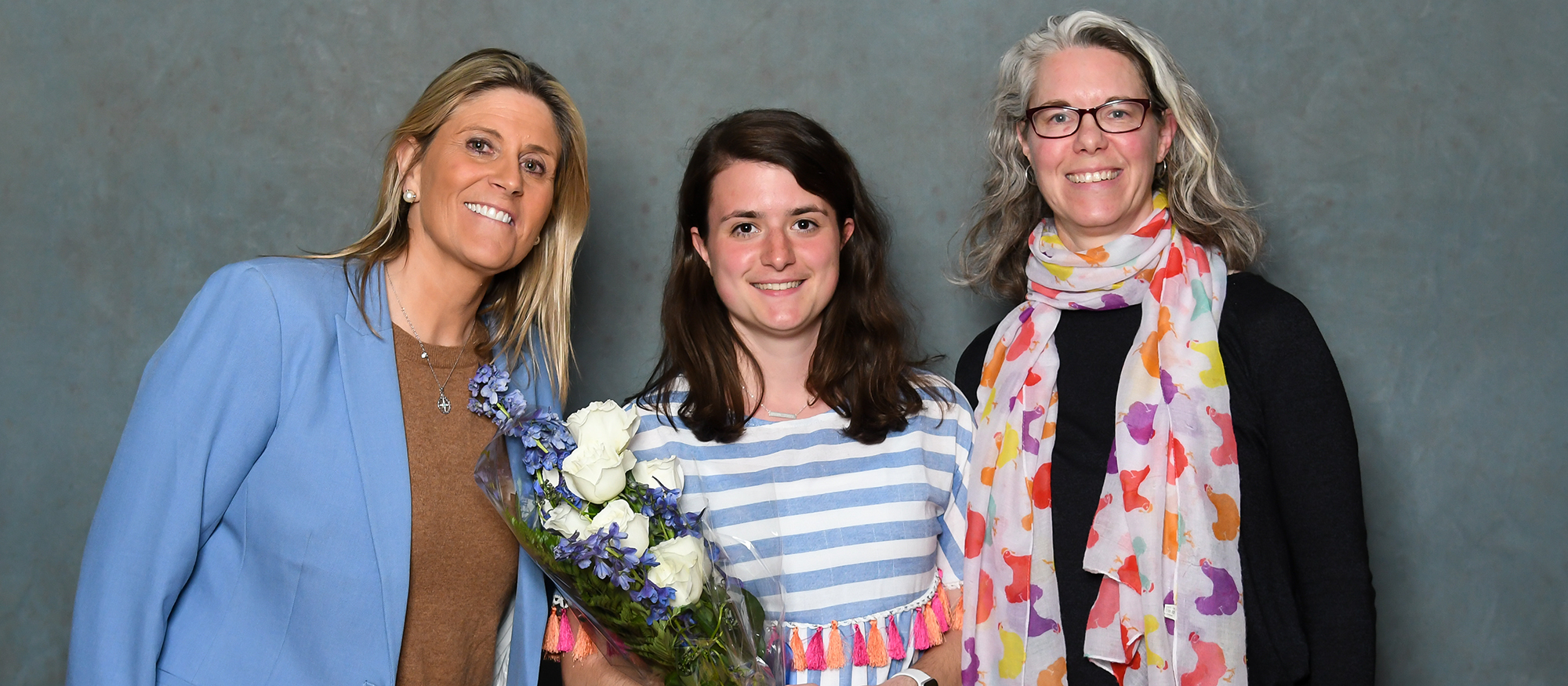 2019 Laurie Priest Alumnae Association Scholar Athlete recipient, senior field hockey captain Mirjam Keochakian (center), with head coach Andy Whitcomb (left) and Jen Grow '94, from the MHC Alumnae Association (right).