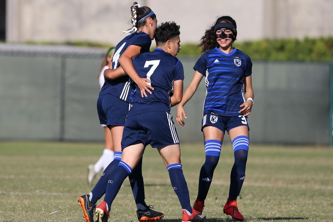 Gabriela Jimenez (7) is greeted by Alessandra Ramirez (4) and America Ontiveros (3) after her goal in the sixth minute