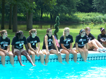 2010 team student-athletes gather poolside at the Leach residence.  (Photo by Joe Gorby)