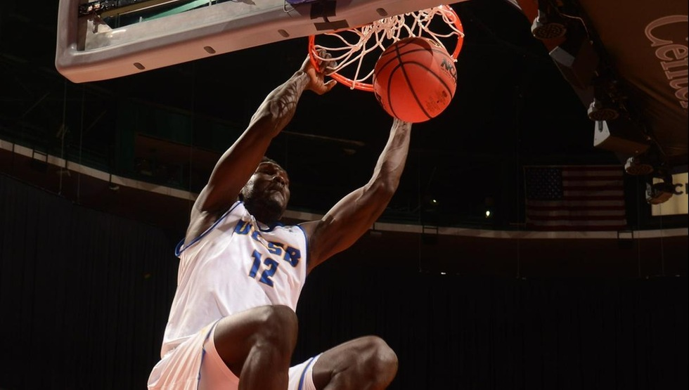 Amadou Sow had 16 points and 11 rebounds in UCSB's 71-68 win over CSUN in the quarterfinals of the Big West Tournament on Thursday afternoon. He scored two of his points on this breakaway slam dunk in the first half. (Photo by Matt Brown)