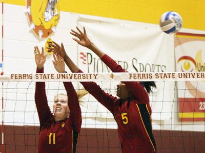 Samantha Fordyce and Arielle Goodson go up for a block attempt in Friday's action against Michigan Tech.  (Photo by The Pioneer)