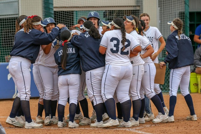 Itzel Soto is mobbed by teammates after her walk-off home run