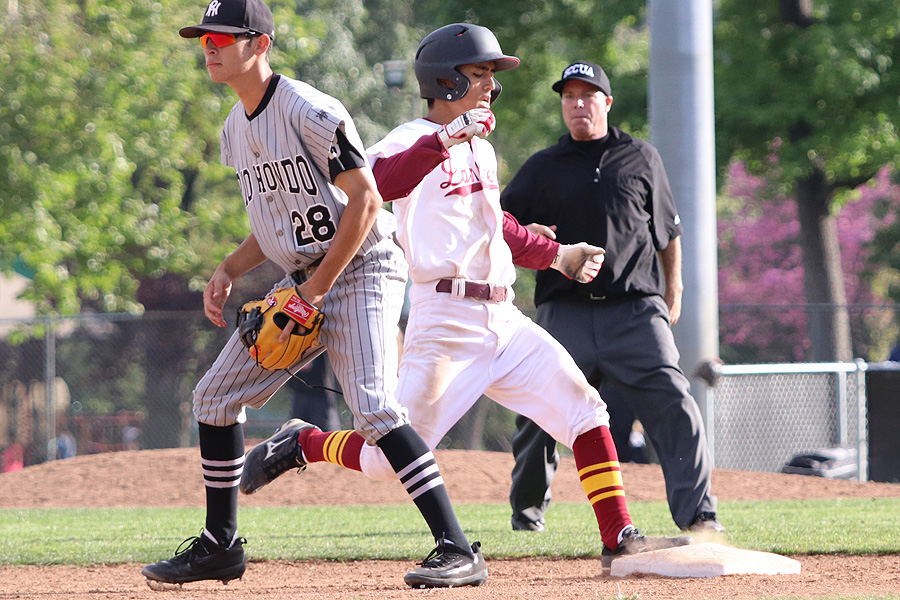 Shane Ogata has become a big part of PCC's hot batting as the Lancers are two games up in first place in the South Coast Conference North Division. He reaches third base here during the team's win on Thursday, photo by Richard Quinton.