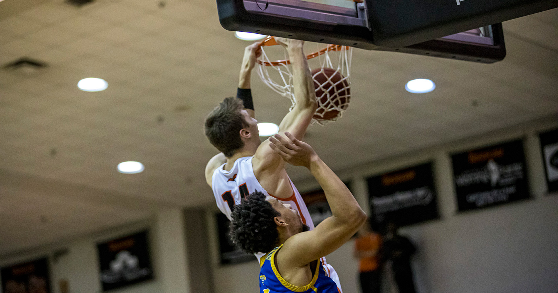 Caleb Hodnett slams this dunk home in Tusculum's 80-66 home win over Mars Hill (photo by Chuck Williams)