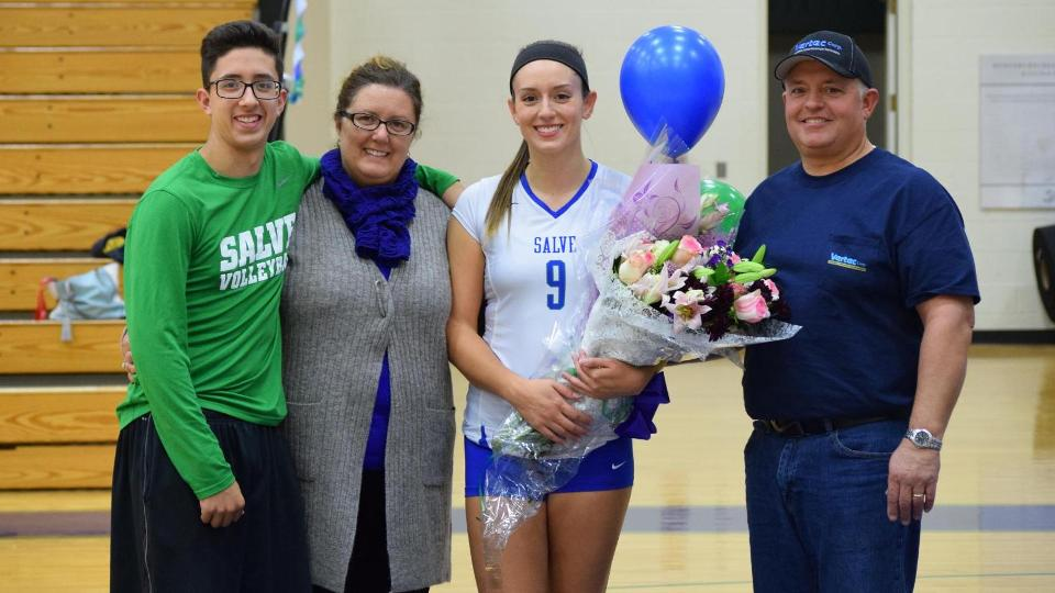 Salve Regina senior Kat Mendes, joined by her family pre-game for a special ceremony.