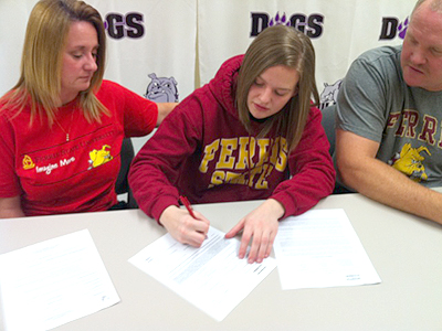 Morgan Miller inks with the Bulldogs as her parents look on (Courtesy Photo)