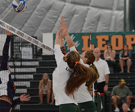 #6 Brittany Yaxley and #21 Cassie Thompson go up for a block against the Sagehens (photo by Kay Hurd)