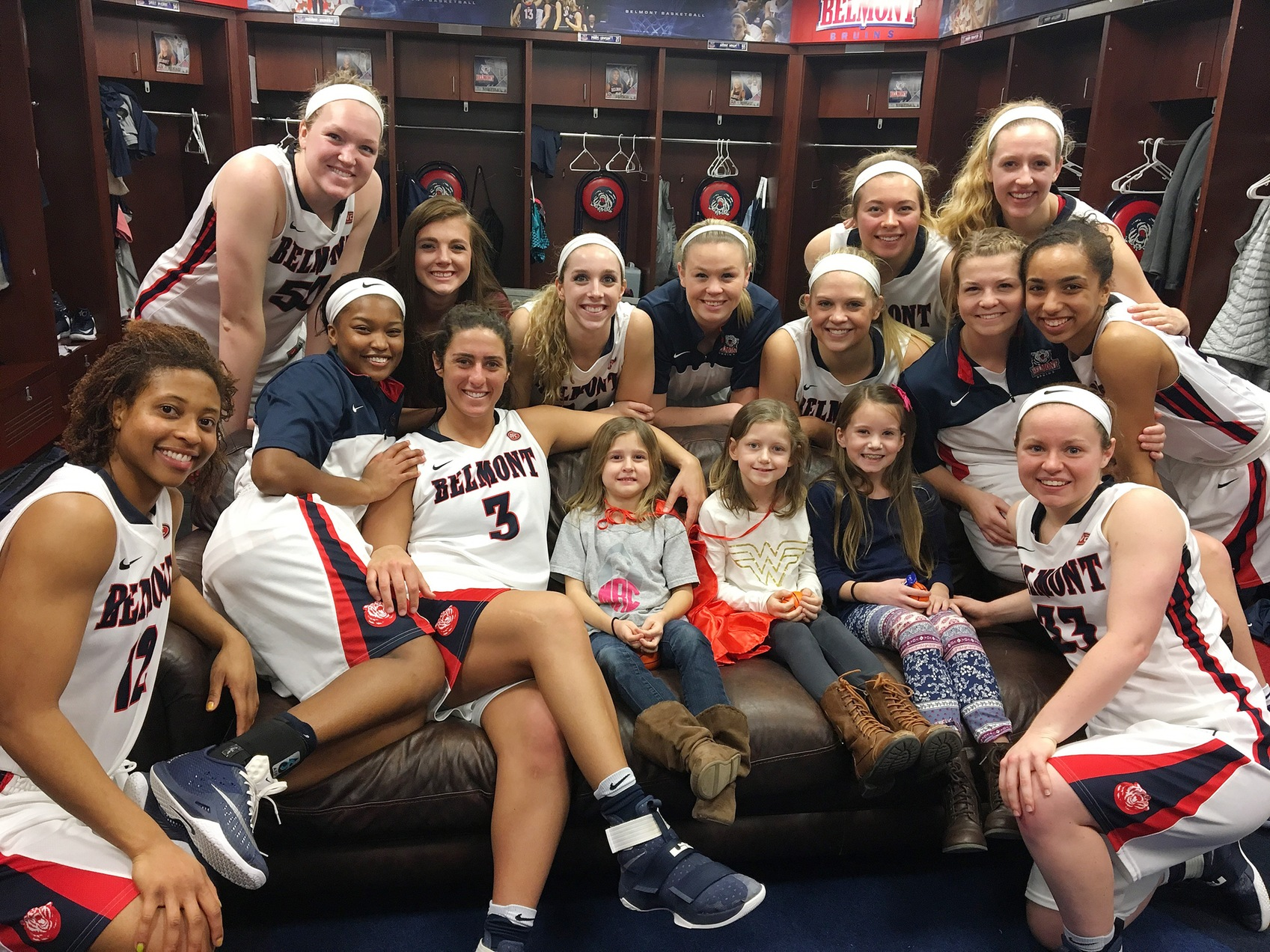 Morgan Rogers, pictured at center with sister Harper (left) and friend Brooklyn Jones (right), in the Belmont women's basketball locker room. (Photo courtesy of Michelle Rogers)