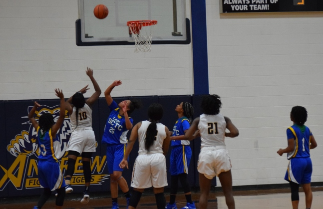 Destiny Reed (10) bangs home a layup