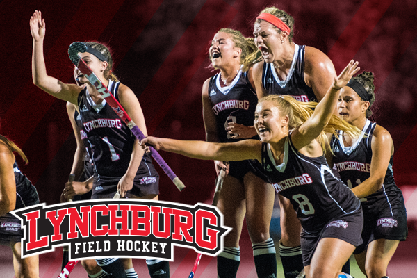 Field hockey players celebrate a goal in the ODAC championship game in 2017. Logo: Lynchburg field hockey.