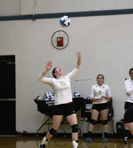 SUNY Broome volleyball player #11 getting ready to serve
