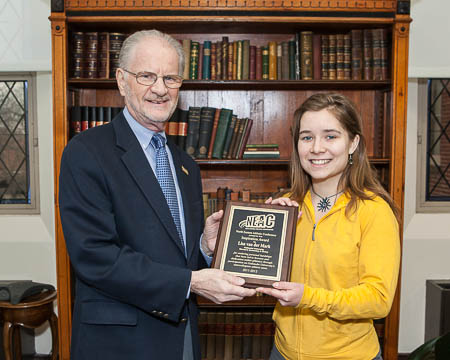 Lisa van der Mark receives plaque from President Hurwitz (left)
