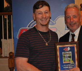 Aaron Brill, shown here receiving his CACC Player of the Year award, earned the same honor from the Daktronics D-II All-East Region program.