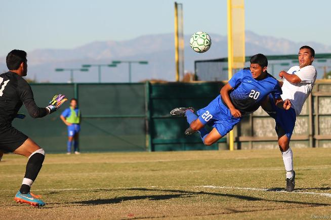 Christian Hernandez scores the Falcons first goal in a 2-1 playoff win over Santiago Canyon