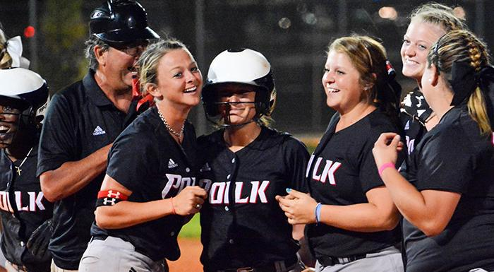 Head Coach Jeff Ellis and the Eagles congratulate Taylor Fike (center) after her walk-off double brought home the tying and winning runs in a 6-5 win over St. Pete. (Photo by Tom Hagerty, Polk State.)