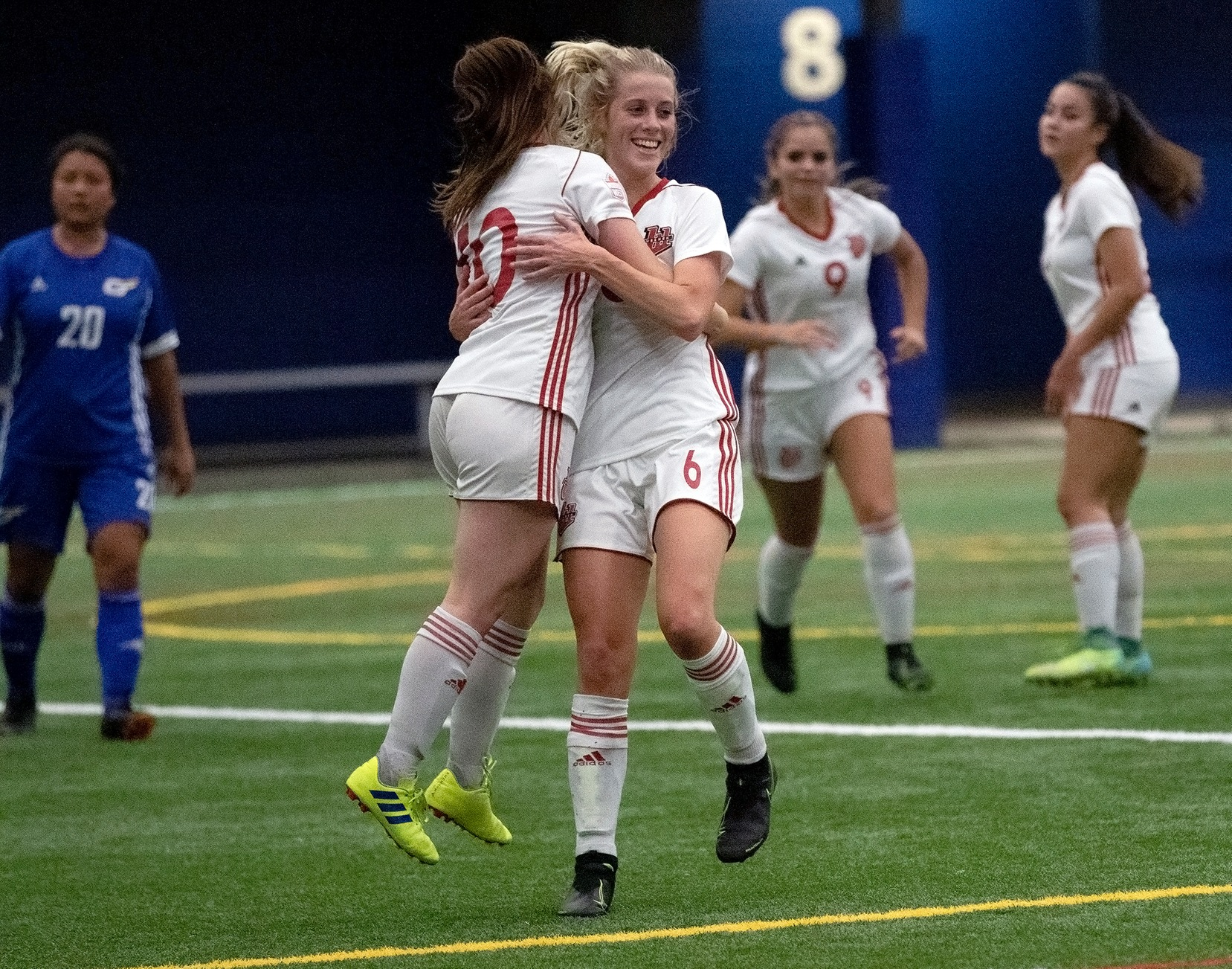 Alycia Mann (left) and Nicole Seavers celebrate Mann's penalty kick goal during Wesmen women's soccer action, Sept. 20, 2019 at the WSF North indoor soccer pitch. (David Larkins/Wesmen Athletics)