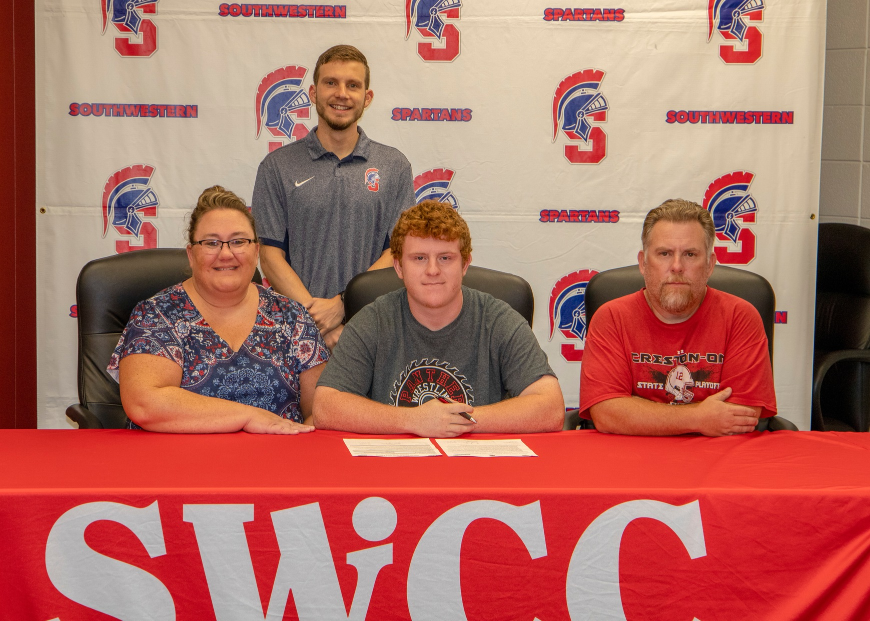 Kendall Crawford of Creston signs his National Letter of Intent to join the Southwestern track and field team for the 2019-20 season.