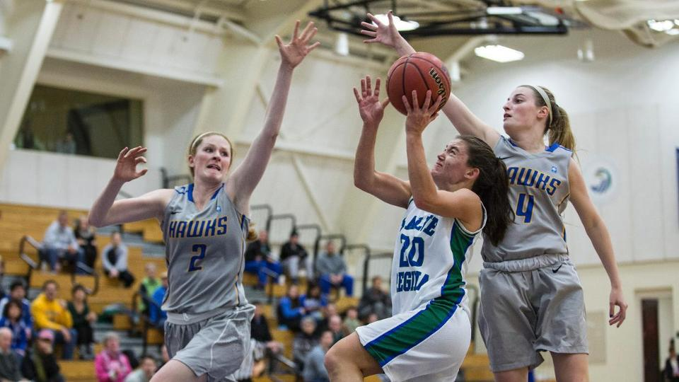 Salve Regina's Laura Anne Dinan (#20) works inside for two of her team-high 18 points against Roger Williams on Tuesday. (Photo by Rob McGuinness)