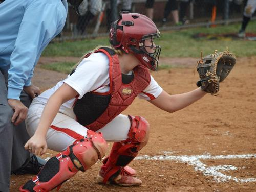 Lady Cards Fall to Crusaders in Conference Doubleheader