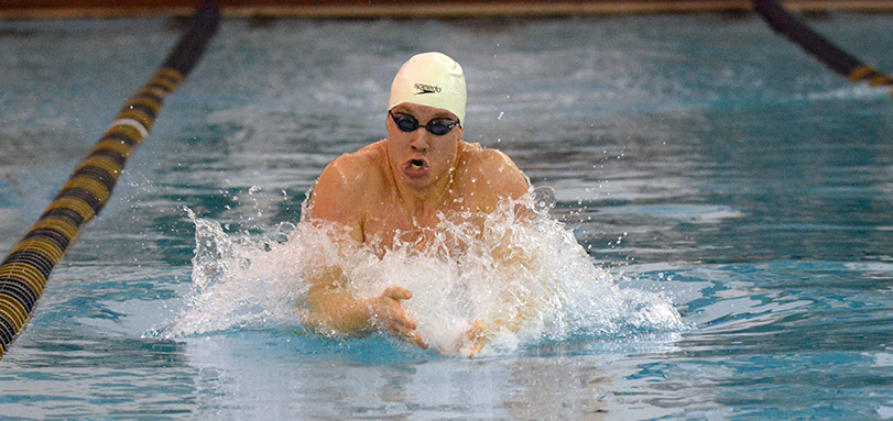 Tyler Thompson won his third straight OAC 100-yard breaststroke title