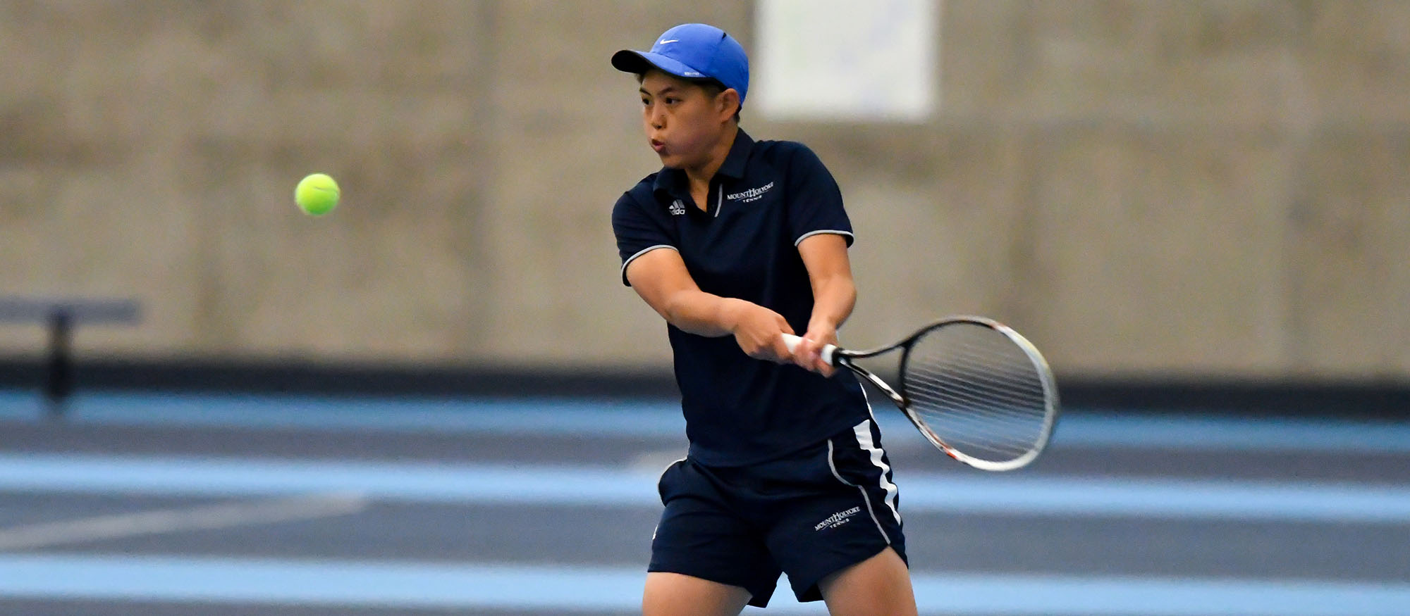 Action photo of Lyons tennis player, Ching-Ching Huang.