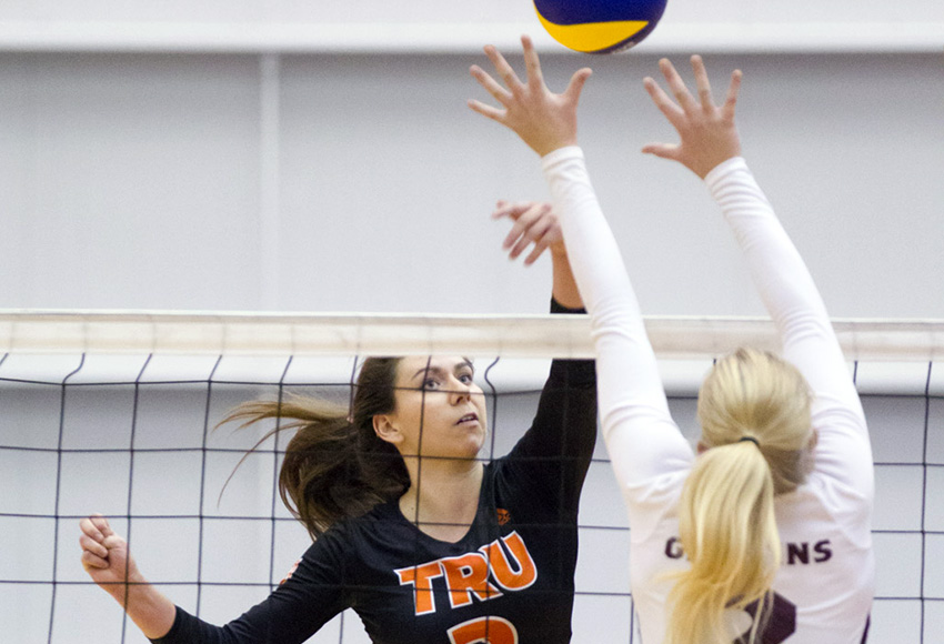 MacEwan's Hailey Cornelis attempts a block on TRU's Mikayla Funk during Saturday's match (Andrew Snucins photo).