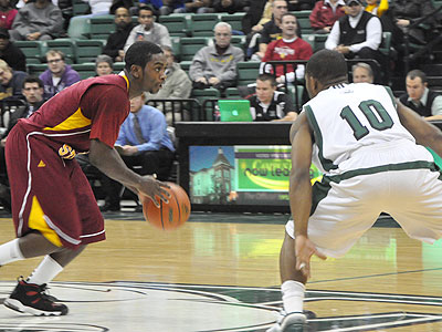FSU's Dontae Molden works the ball up the floor at Eastern Michigan (Photo by Rob Bentley)