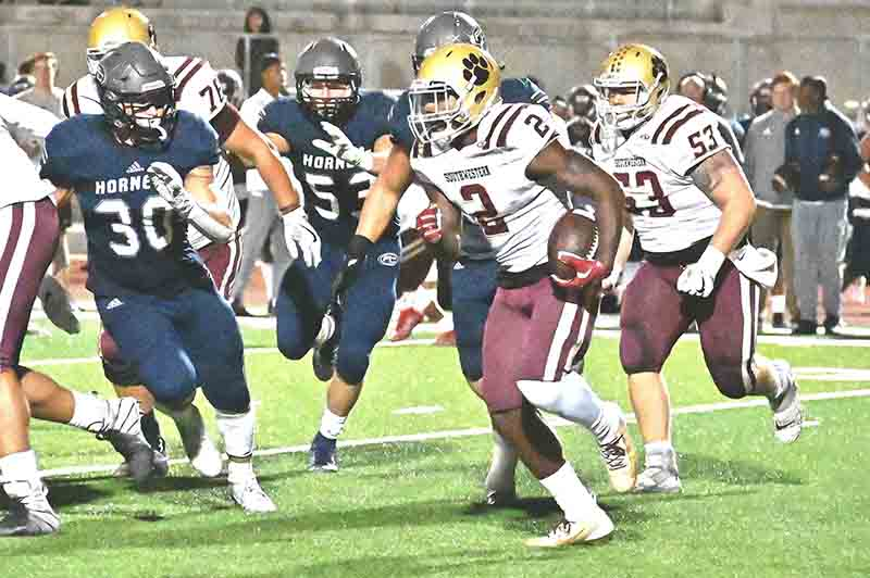 Jag running back Keylan Chapman picks up yardage on the way to 172 yards rushing
