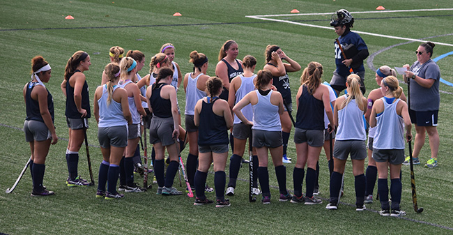 Head Coach Kristen Gillis talks with her squad on the opening day of preseason camp.